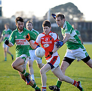 30-11-2014 Rathmore's John Moynihan holds possession in the East Kerry final in Kilarney on Sunday.<br /> Picture by Don MacMonagle