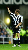 Photo. Jed Wee.<br /> Newcastle United v NAC Breda, UEFA Cup, St. James' Park, Newcastle. 24/09/2003.<br /> Newcastle's Craig Bellamy gives a section of the crowd the finger after scoring his first goal.