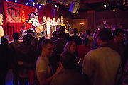An enthusiastic crowd listens to the band Cherven Traktor play traditional Bulgarian music.