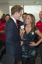 Prince Harry with Natalie Pinkham on the Trading Floor during the BGC Partner's 7th Annual Charity Trading Day, at Churchill Place in Canary Wharf, east London.