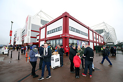 Fans buy match programmes before the Premier League match at the bet365 Stadium, Stoke.