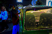 A woman poses by a vehicle transformed into an aquarium at Sea World Ancol in Jakarta.