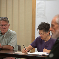 From left, Gerald O'Hara, JoAnn Benenati and Bill Bright open the Sustainable Gallup Board meeting at Octavia Fellin public library in Gallup Tuesday.