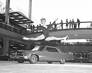 Y-661005A.  Lloyd Center, Chrysler auto show. Advance publicity photos. Dianne Schatz, professional ice skater. October 5, 1966 (Lloyd center before roof built over the mall)