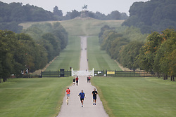 © Licensed to London News Pictures. 01/09/2021. Windsor, UK. People exercise on a cloudy day on the Long Walk near Windsor Castle. Today is the first day of meteorological autumn. Photo credit: Peter Macdiarmid/LNP
