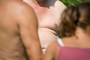 bare breasted obese man