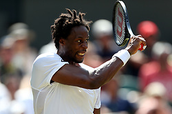 Gael Monfils in action against Kyle Edmund on day four of the Wimbledon Championships at The All England Lawn Tennis and Croquet Club, Wimbledon.