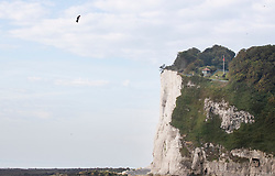 © Licensed to London News Pictures. 04/08/2019. Dover, UK. French inventor Franky Zapata heads to St Margarets Bay near Dover after crossing the English Channel on his jet-powered hoverboard. He is hoping to make the 35km crossing with a refueling stop mid channel to reach the English coast after setting off at 6am French time. Photo credit: Peter Macdiarmid/LNP