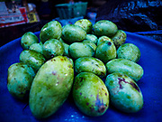 07 AUGUST 2017 - BEBANDEM, BALI, INDONESIA: Mangoes for sale in the market in Bebandem, in far eastern Bali. The market is known for baskets, which are woven in the area. Bali's local markets are open on an every three day rotating schedule because venders travel from town to town. Before modern refrigeration and convenience stores became common place on Bali, markets were thriving community gatherings. Fewer people shop at markets now as more and more consumers go to convenience stores and more families have refrigerators.     PHOTO BY JACK KURTZ