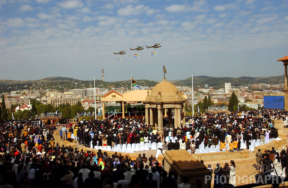 PRETORIA, SOUTH AFRICA - APRIL-27-2004 -.Three helicopters fly the South African flag over the inauguration ceremony for South African President Thabo Mbeki , which marks the 10th Anniversary of the fall of Apartheid in South Africa. (PHOTO © JOCK FISTICK)