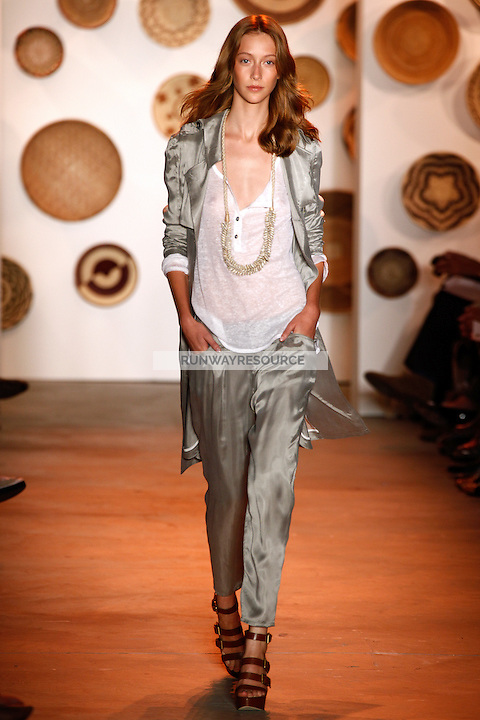 Alana Zimmer walks the runway wearing Adam spring 2010 collection during Mercedes-Benz Fashion Week in New York City on September 12, 2009