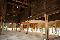 The barn attached to the Pickering House now sits on top of a new foundation with new floor joists as renovations are underway by Peter and Patty Cooke to restore the property for guests in 2018.  (Karen Bobotas/for the Laconia Daily Sun)