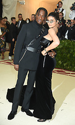 Kylie Jenner and Travis Scott attends the Costume Institute Benefit at the Metropolitin Museum of Art at the opening of Heavenly Bodies: Fashion and the Catholic Imagination on May 7, 2018 in New York, New York, USA.