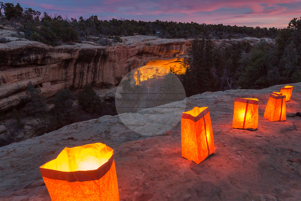 Spruce Tree House the best preserved of the Native American cliff dwellings is illuminated by hundreds of small paper lanterns known as luminaria to celebrate the holiday season during open house December 10, 2015 in Mesa Verde National Park, Colorado.