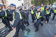 Riot police reserves arrive in teh centre - Crowds flock to see the 50th Notting hill carnival on Bank Holiday Monday.