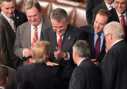 """United States President Donald J. Trump is given a """"thumbs-up"""" by US Representative Peter King (R-NY) after addressing a joint session of Congress on Capitol Hill in Washington, DC, USA, February 28, 2017. Photo by Chris Kleponis/CNP/ABACAPRESS.COM"""