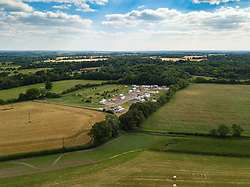 An aerial view of the Traveller encampment set up without planning permission on farmland near the village of Little Hadham in the lush Hertfordshire countryside. Little Hadham, Herts, July 04 2019.