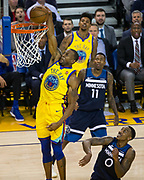 Golden State Warriors forward Andre Iguodala (9) dunks the ball against the Minnesota Timberwolves at Oracle Arena in Oakland, Calif., on January 25, 2018. (Stan Olszewski/Special to S.F. Examiner)