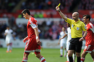 Southampton's Jose Fonte is booked by referee Anthony Taylor after he fouls Swansea's Pablo Hernandez. Barclays Premier league match, Swansea city v Southampton at the Liberty stadium in Swansea, South Wales on Saturday 3rd May 2014.<br /> pic by Andrew Orchard, Andrew Orchard sports photography.
