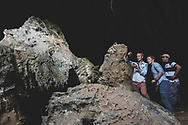 Travelers explore the entrance to a cave with their Cuban guide on the outskirts of Viñales, Cuba. (December 9, 2014)