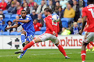 Cardiff's Junior Hoilett (l) shoots at goal whilst being challenged by Nottingham's Daniel Fox. EFL Skybet championship match, Cardiff city v Nottingham Forest at the Cardiff City Stadium in Cardiff, South Wales on Easter Monday 17th April 2017.<br /> pic by Carl Robertson, Andrew Orchard sports photography.