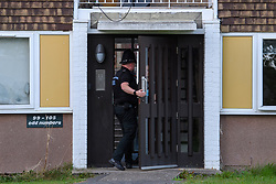 © Licensed to London News Pictures. 16/09/2021. Reading, UK. A police officer at the front entrance of a property in Hadrian Walk East in Whitley, Reading following the discovery of a body in Erith, London on Wednesday 15/09/2021. A murder investigation was launched by Thames Valley Police's Major Crime Unit in connecting with a missing person investigation that was launched on 24/08/2021 following a report that a person had gone missing from the Reading area. Photo credit: Peter Manning/LNP