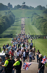 © Licensed to London News Pictures. 19/05/2018. Windsor, UK. Royal fans head towards viewing areas on the Long Walk before the arrival of The Duke and Duchess of Sussex after the marriage ceremony at Windsor Castle. Photo credit: Peter Macdiarmid/LNP