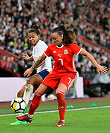 Nikita Parris (7) of England battles for possession with Natasha Harding (7) of Wales during the FIFA Women's World Cup UEFA Qualifier match between England Ladies and Wales Women at the St Mary's Stadium, Southampton, England on 6 April 2018. Picture by Graham Hunt.