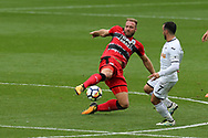 Laurent Depoitre of Huddersfield Town gets the ball ahead of Leon Britton of Swansea city ®. Premier league match, Swansea city v Huddersfield Town at the Liberty Stadium in Swansea, South Wales on Saturday 14th October 2017.<br /> pic by  Andrew Orchard, Andrew Orchard sports photography.