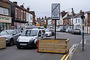 Drivers pass through Low-traffic neighbourhood barriers put in place in Kings Heath on 16th November 2020 in Birmingham, United Kingdom. These traffic restrictions, many of which have been rushed through by local councils during the Coronavirus pandemic have created controversy in local communities, many of whom object the road closures which affect some businesses and roads adversely. The green measures, which have been named 'places for people' by Birmingham City Council are designed reduce traffic and to promote walking and cycling have been criticised for being environmentally unsound, and forcing traffic onto previously quiet roads.