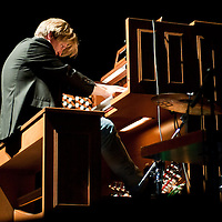 Musicians Xaver Varnus and Rhoda Scott (not pictured) perform on the organ during a concert held together titled duel of the organists in Budapest, Hungary on April 10, 2011. ATTILA VOLGYI