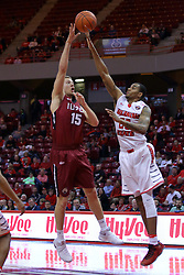 26 November 2016:  Deontae Hawkins(23) attempts to block the shot by Matt O'Leary during an NCAA  mens basketball game between the IUPUI Jaguars the Illinois State Redbirds in a non-conference game at Redbird Arena, Normal IL
