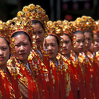 USA, Washington, Seattle, Chinese Community Girls Drill Team performs in International District at Summer Festival