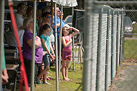 Kiwanis and guests stand and salute as the boy scouts raise the flag during the 70th Anniversary celebration of the Kiwanis Pool in St. Johnsbury Vermont.  Karen Bobotas / for Kiwanis International