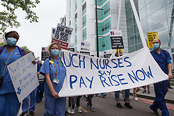 London, UK. 3rd July, 2021. NHS workers and supporters take part in a protest march from University College Hospital (UCH) to Whitehall as part of a national day of action to mark the 73rd birthday of the National Health Service. The protesters called for fair pay for NHS workers, for better funding of the NHS and for an end to privatisation measures affecting the NHS.