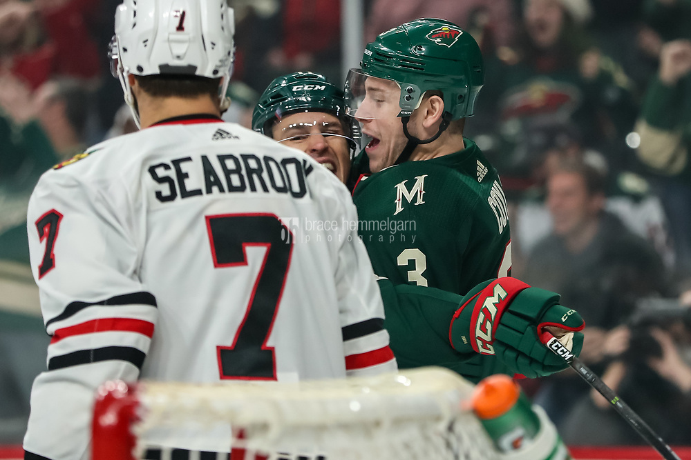 Feb 10, 2018; Saint Paul, MN, USA; Minnesota Wild forward Charlie Coyle (3) celebrates his goal with forward Zach Parise (11) during the first period against the Chicago Blackhawks at Xcel Energy Center. Mandatory Credit: Brace Hemmelgarn-USA TODAY Sports