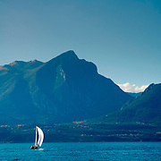 Sailboat at Lake Garda with mountains on the back