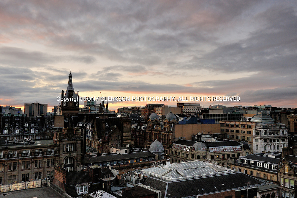 Dramatic Glasgow skyline as the sun sets over the centre of the city