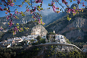View looking up at the upper half of Positano and the cliffs beyond, Amalfi Coast, Campagna, Italy.