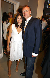GARY KEMP and his wife LAUREN at an exhibition of photographs by the late Robert Mapplethorpe at the Alison Jacques Gallery, 4 Clifford Street, London W1 on 7th September 2006.<br />