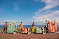 Community arts event Art Walk Porty got underway this afternoon with a promenade procession of the event's 'Art Carts'. The carts, designed to echo the old style bathing carts that used to grace Portobello beach, will be used in a variety of ways by different artists at locations across Portobello, Edinburgh's seaside suburb. The Art Walk is now in its third year and will run over the next day days with a range of events and exhibitions. Pictured: Artists Jude Nixon, Jill Martin Boualaxai, Jenny Martin and Peter Jones.<br /> <br /> <br /> <br /> © Jon Davey/ EEm