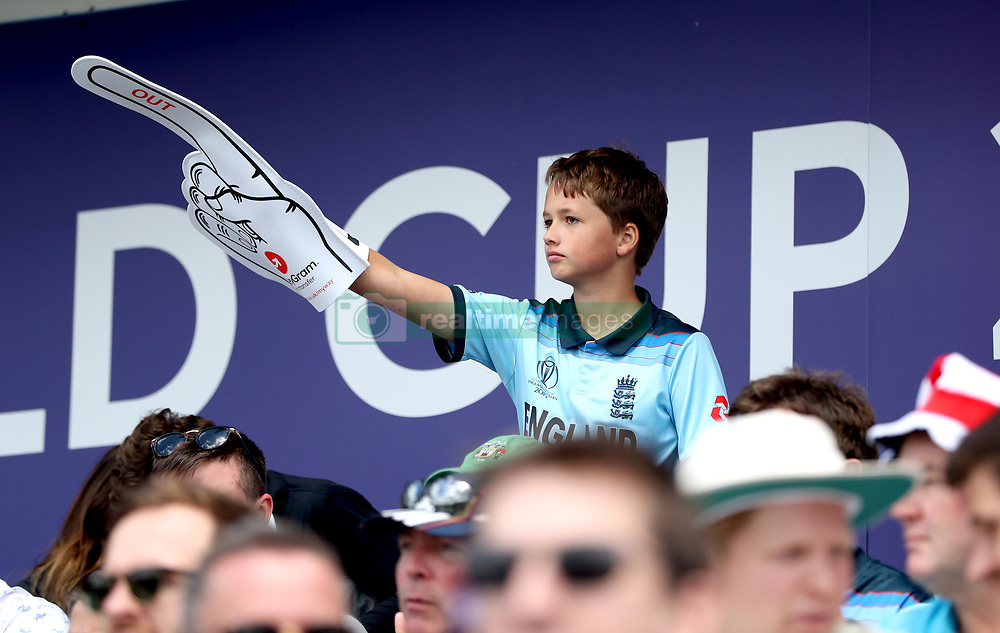 An England fan in the stands with a foam finger during the ICC Cricket World Cup group stage match at Headingley, Leeds.