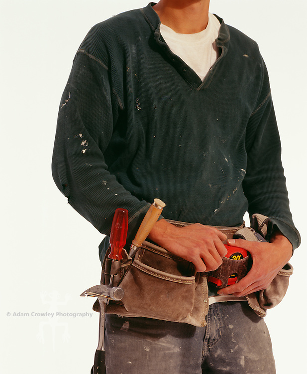 Carpenter with tool belt, mid section