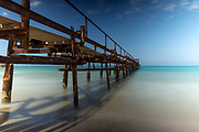 Rusted wharf protruding into the Mediterranean Sea at Atlit, Israel