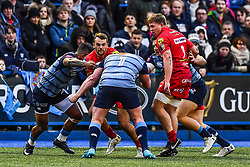 Scarlets' Paul Asquith is tackled by Cardiff Blues' Rhys Gill - Mandatory by-line: Craig Thomas/Replay images - 31/12/2017 - RUGBY - Cardiff Arms Park - Cardiff , Wales - Blues v Scarlets - Guinness Pro 14