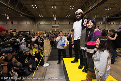 Kosuke Saito and his family gets introduced to the crowd at the Annual Mooneyes Yokohama Hot Rod and Custom Show. Japan. Sunday, December 7, 2014. Photograph ©2014 Michael Lichter.