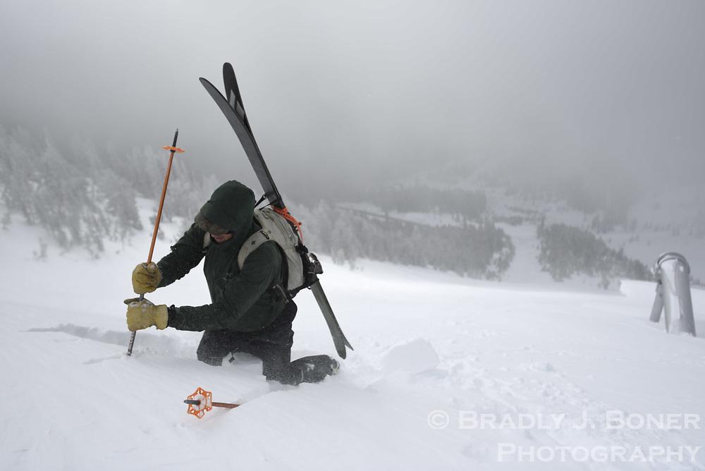 WYDOT avalanche technicians John Fitzgerald and Brendan Cronin on daily rounds on Teton Pass.