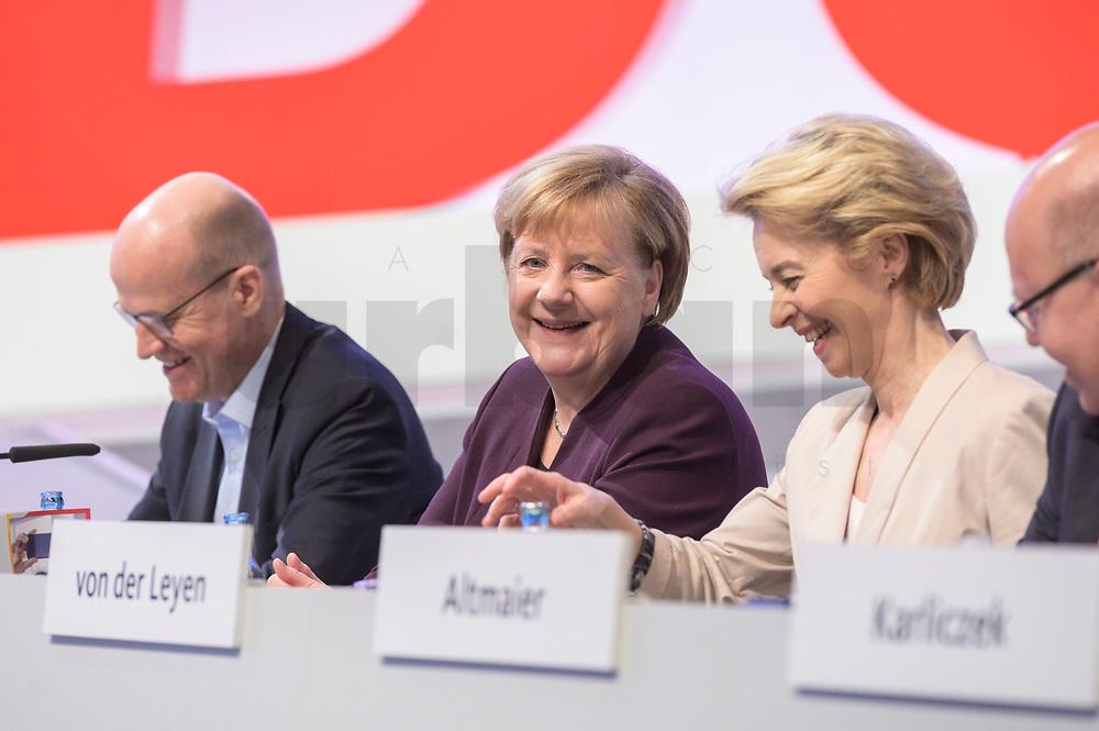 22 NOV 2019, LEIPZIG/GERMANY:<br /> Ralph Brinkhaus, CDU, Vorsitzender der CDU/CSU Bundestagsfraktion, Angela Merkel, CDU, Bundeskanzlerin, und Ursula von der Leyen, CDU, gewaehlte Praesidentin der Europaeischen Kommission (v.L.n.R.), CDU Bundesparteitag, CCL Leipzig<br /> IMAGE: 20191122-01-024<br /> KEYWORDS: Parteitag, party congress, lacht, lachen, freundlich