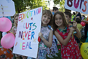 Hackney parents and their children mobilise against threat of cuts to schools across the borough, in a demonstration rally on May 26th 2017 in London Fields in East London, United Kingdom. In response to the threat of cuts, parents, students and teachers gathered together to form a 'big assembly' in parks across Hackney.  London's schools are facing greater losses due to the government's proposed national funding formula that i seeking to redistribute funding across the country. Under these policies, Hackney schools would face an estimated 22.3 per cent loss or £914 per-pupil reduction by 2020.