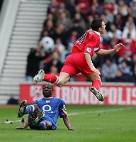 Photo. Andrew Unwin, Digitalsport<br /> Middlesbrough v Arsenal, Barclays Premiership, Riverside Stadium, Middlesbrough 09/04/2005.<br /> Middlesbrough's Stewart Downing (R) is sent flying by Arsenal's Lauren (L).
